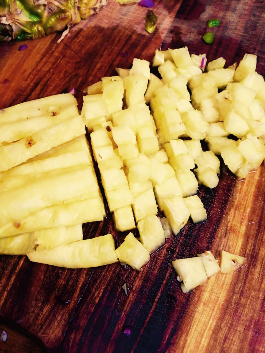 Dicing pineapple for Pineapple salsa. Vying For Veganism.