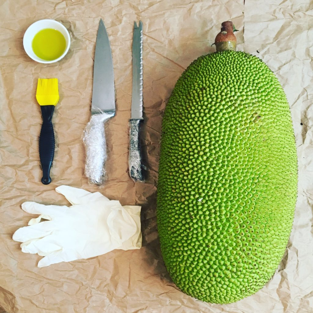 Setting up for the task. Jackfruit, wrapped knives, oil, gloves and surface paper. Vying for Veganism